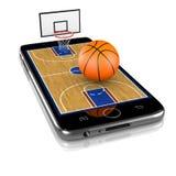 Basketball auf Smartphone, Sport-APP Stockbilder