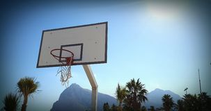 Basketball backboard. A basketball backboard and mountains in the background Royalty Free Stock Photography