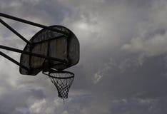 Basketball backboard in darkening skies. Stock Photography