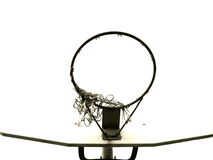 Basketball Backboard, Hoop and Tattered Net. (Black and White)  The bottom of a backboard, hoop, and net is all which shows against a cloudy sky Royalty Free Stock Photo