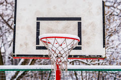 Basketball backboard and red rim in winter Royalty Free Stock Photography