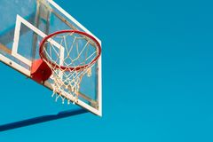 Basketball backboard with ring and hoops on outdoor court stock photos