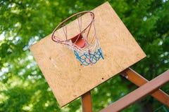 Basketball backboard. Wooden basketball backboard in park royalty free stock photography