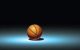 Basketball background. Shiny orange basket ball on spotlight Stock Photo