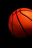 Basketball ball. On black background Stock Images