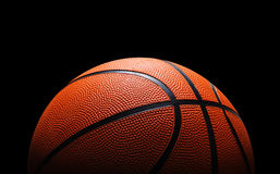 Basketball. Ball against black background Royalty Free Stock Photo