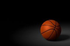 Basketball-Ball auf schwarzem Hintergrund, Wiedergabe 3D Lizenzfreies Stockbild