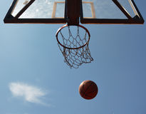 Basketball ball and basket Stock Photography
