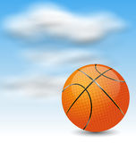 Basketball Ball on Cloudy Sky Background Stock Image
