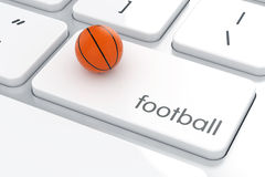 Basketball ball on the computer keyboard Stock Photo