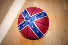 Basketball ball with the confederate flag. Lying on the floor near the white line Stock Photos