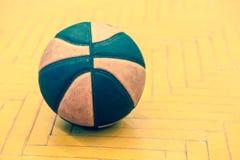 Basketball ball on the court Stock Photography