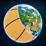 Basketball ball cover the planet earth. sports Stock Photo