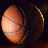 Basketball ball in dark Stock Image