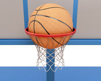 Basketball ball falling into a ring close-up. 3d illustration Royalty Free Stock Images