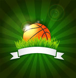 Basketball ball on field grass with white ribbon and lights effect Stock Photos