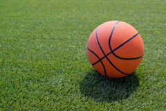 Basketball ball on the field Stock Images