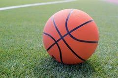 Basketball ball on the field Stock Photos