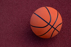 Basketball ball on the field. Basketball ball on a soccer field on a summer day Royalty Free Stock Images