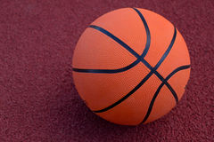 Basketball ball on the field Royalty Free Stock Photo