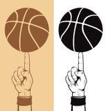 Basketball Ball On The Finger Stock Images