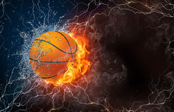 Basketball ball in fire and water. Basketball ball on fire and water with lightening around on black background. Horizontal layout with text space Royalty Free Stock Photography