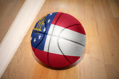 Basketball ball with the flag of georgia state. Lying on the floor near the white line Royalty Free Stock Photography