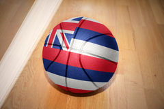 Basketball ball with the flag of hawaii state royalty free stock photography