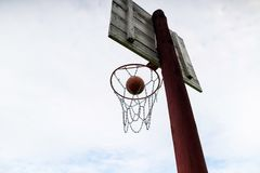 Basketball ball flies into a basket,goal,2 points, outdoor game,. Championship stock photos