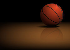 Basketball ball on the floor Royalty Free Stock Photography