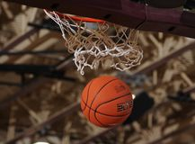 Basketball ball going through the net. Stock Photography