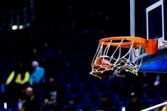Basketball ball going through the net Stock Photo