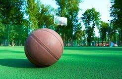 Basketball ball on green field floor Stock Photo