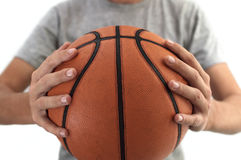 Basketball ball in hands. Royalty Free Stock Photography