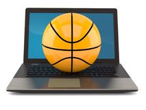 Basketball ball with laptop isolated. Isolated on white background. 3d illustration Royalty Free Stock Photography