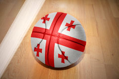 Basketball ball with the national flag of georgia. Lying on the floor near the white line Royalty Free Stock Photography