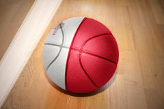 Basketball ball with the national flag of malta. Lying on the floor near the white line Stock Photography