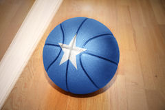 Basketball ball with the national flag of somalia. Lying on the floor near the white line Stock Photo