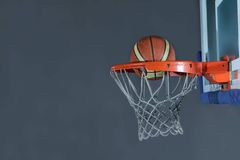 Basketball ball and net on grey background Stock Photo