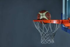 Basketball ball and net on grey background Royalty Free Stock Photo