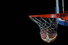 Basketball ball and net on grey background Royalty Free Stock Images