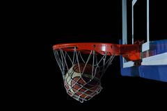 Basketball ball and net on grey background Royalty Free Stock Image
