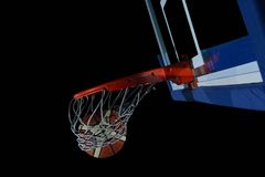 Basketball ball and net on grey background Stock Images
