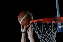 Basketball ball and net on grey background. Basketball ball,  board and net  on grey  background in gym indoor Royalty Free Stock Photography