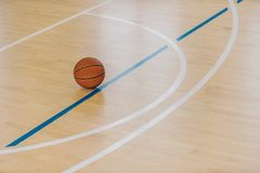Basketball ball over floor in the gym royalty free stock image