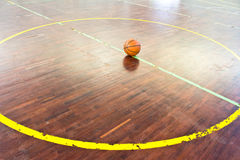 Basketball ball over floor Royalty Free Stock Images