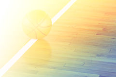 Basketball ball over floor in the gym Stock Photography