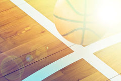 Basketball ball over floor in the gym Stock Images