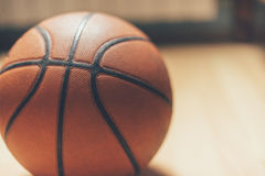 Basketball. Ball on the parquet Royalty Free Stock Photos