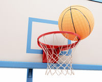 Basketball ball on the ring. Close-up. 3d render image Royalty Free Stock Image